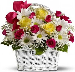 Basket of bright roses, daisies or gerberas and mixed flowers