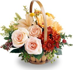 Basket of delicate roses, lilies, gerberas and mixed flowers