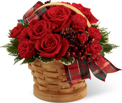 Basket of roses and mixed flowers in warm colors