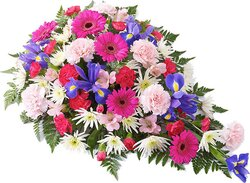 Bright funeral spray of gerberas, carnations and mixed flowers