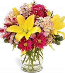 Bright lilies, daisies or gerberas and mixed flowers