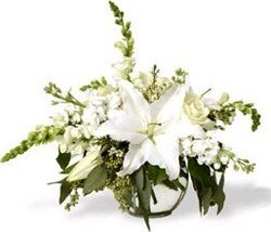 Delicate funeral bouquet of lilies, roses and mixed flowers