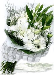 Delicate funeral bunch of lilies, gerberas and mixed flowers