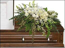 Delicate funeral spray of roses, lilies, carnations and mixed flowers