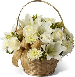 Funeral basket of delicate roses, lilies and mixed flowers