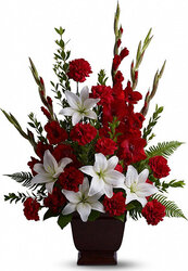 Funeral bowl of red and white lilies and carnations