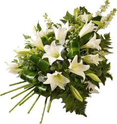 Funeral bunch of delicate lilies and mixed flowers