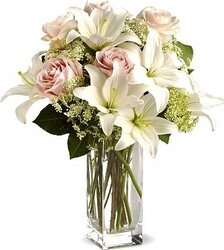 Funeral bunch of delicate roses and lilies