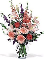 Funeral bunch of pastel roses, lilies, gerberas and mixed flowers