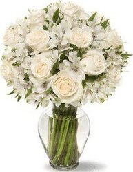 Funeral bunch of roses and mixed flowers in light colors