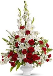Funeral bunch of white and red roses, lilies, carnations and mixed flowers