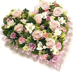 Funeral heart of pastel roses, carnations and mixed flowers