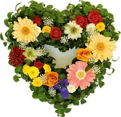 Funeral heart of roses, gerberas and mixed flowers
