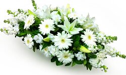 Funeral spray of delicate gerberas, lilies and mixed flowers
