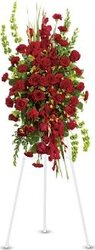 Funeral spray of roses and mixed flowers in warm colors