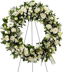 Funeral wreath of delicate roses and/or lisianthuses and mixed flowers