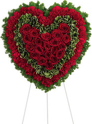 Funeral wreath of red roses and carnations