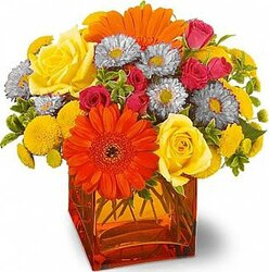 Gerberas or daisies, roses and mixed flowers in warm colors