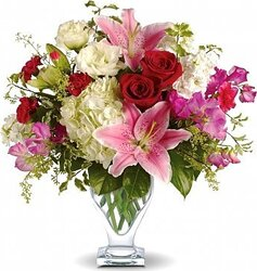 Lilies, roses, lisianthuses and mixed flowers in warm colors