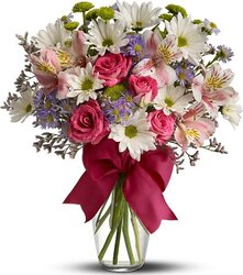 Pastel roses, daisies or gerberas, alstroemerias and mixed flowers