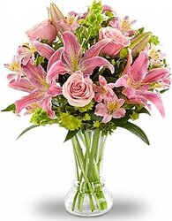 Pink lilies, roses, alstroemerias and mixed flowers