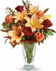 Roses, lilies and mixed flowers in warm colors
