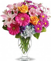 Roses, lilies, gerberas and mixed flowers in festive colors