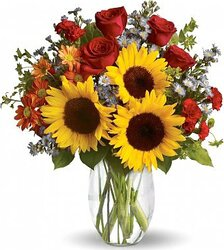 Sunflowers, roses, daisies or gerberas and mixed flowers in warm colors