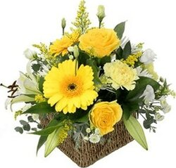 Sunny basket of roses, gerberas, lisianthuses and mixed flowers