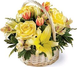 Sunny basket of roses, lilies, alstroemerias and mixed flowers