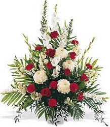White and red funeral bowl of roses and mixed flowers