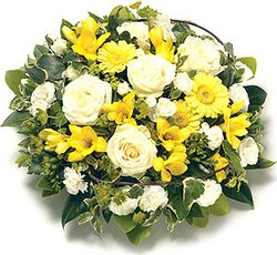 Yellow and white arrangement of roses, gerberas, carnations and mixed flowers